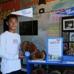 Boy holding a catcher's mitt from the Mitt Mobile