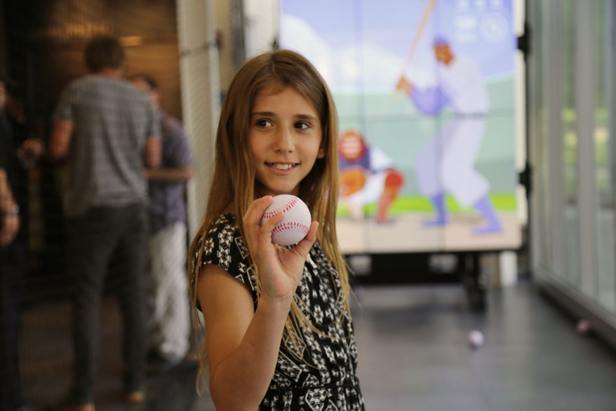 Girl with a baseball at the Pitch! exhibition
