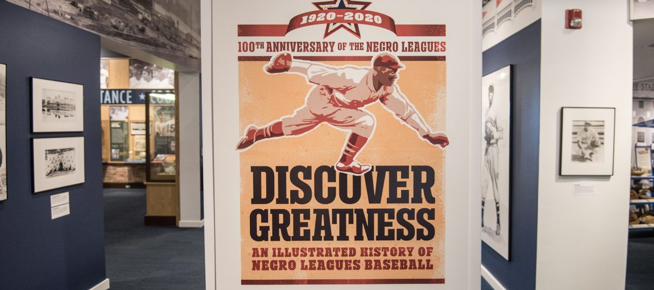 Poster for the Discovering Greatness exhibition