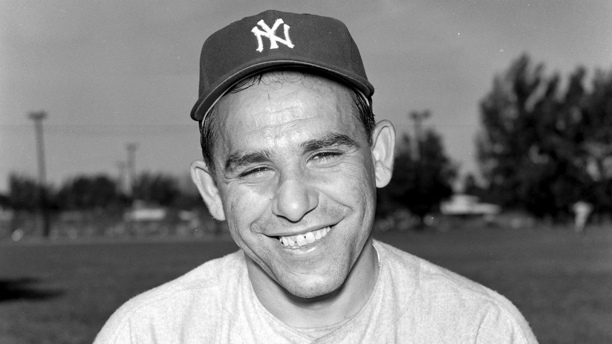Yogi Berra smiling with a NY Yankees cap
