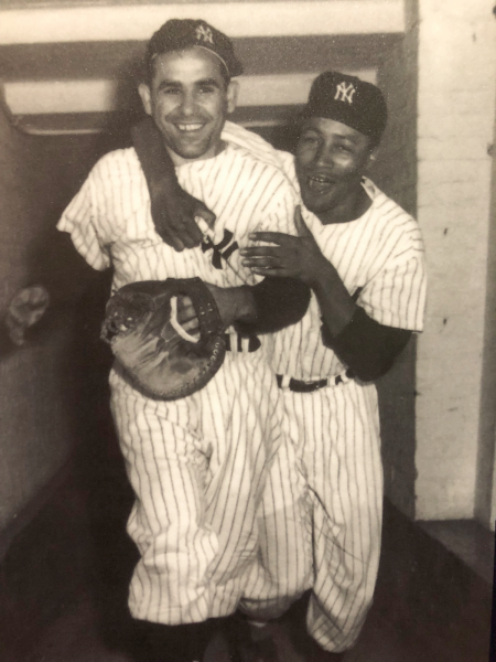 Yogi Berra with fellow catcher and first black New York Yankee, Elston Howard, 1955