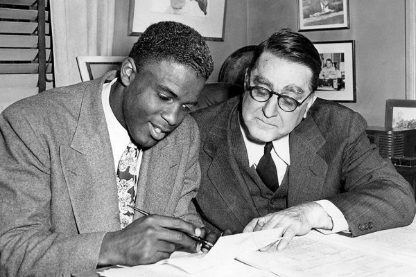 Black baseball player being signed.