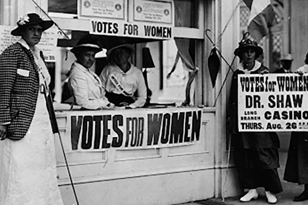 Image with Votes for Women signs.