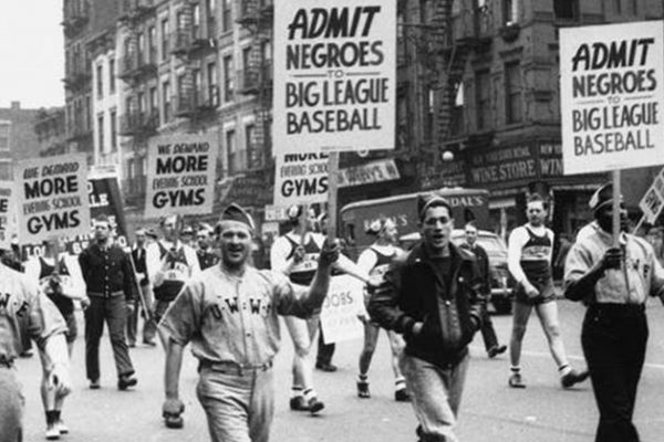 People marching holding signs for African American rights.