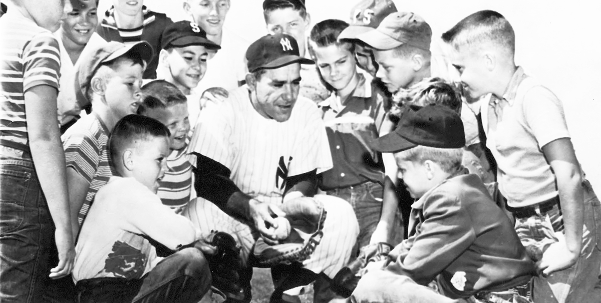 Yogi Berra as a Yankees player talking to several children
