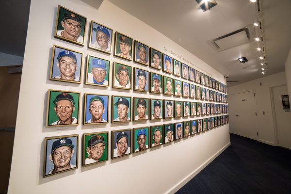 Wall of Andy Jurinko's 76 oil paintings, portraits of players that defined Yogi's era