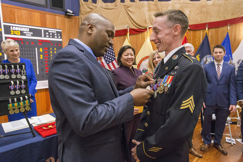 Col. Jemal J. Beale presenting Sgt. Robert Rumsby with the New Jersey Distinguished Service Medal in the Museum's stadium-style theater