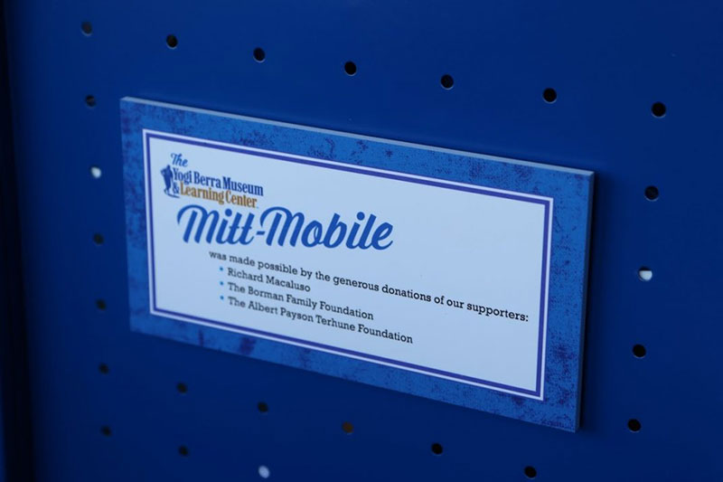 Close-up of supporters plaque on the Mitt Mobile