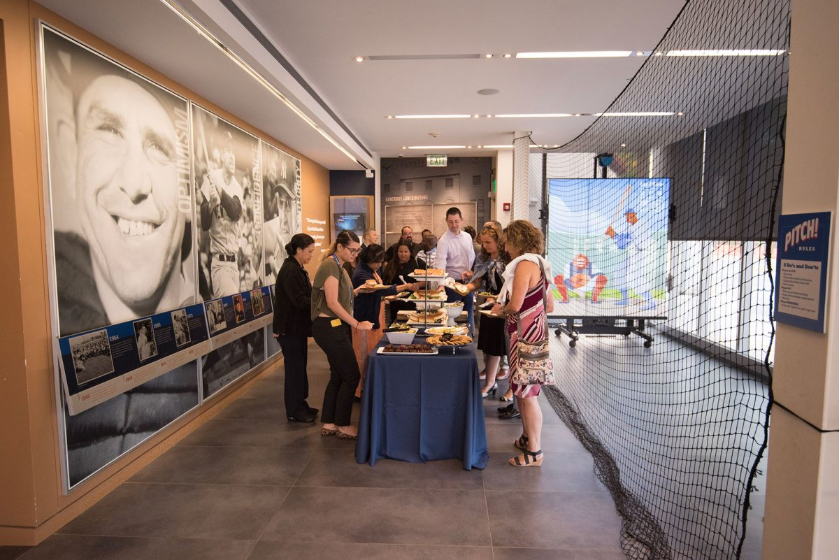 Event guests at a food table in the Museum