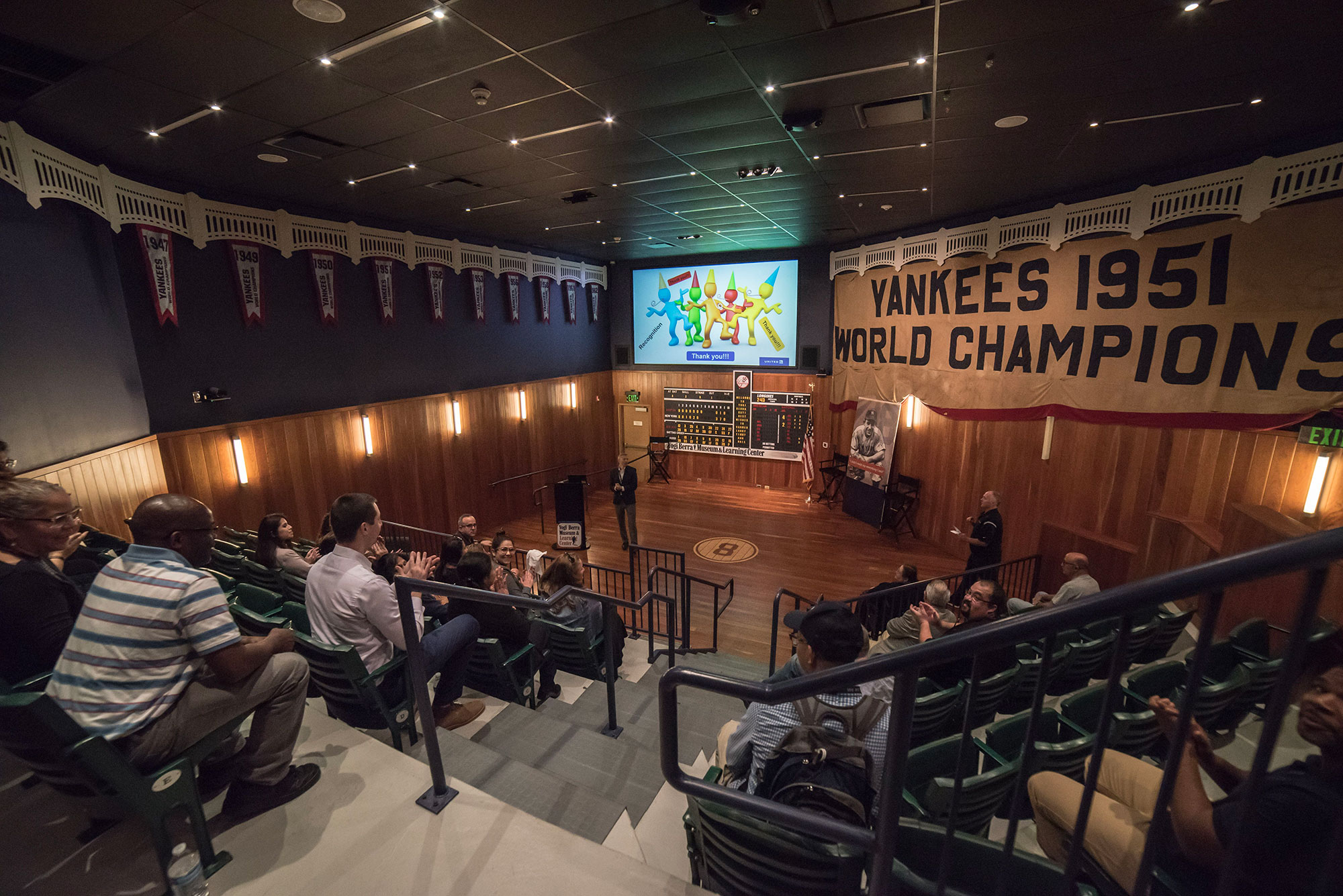 The Museum's 65-seat stadium-style theater filled with visitors