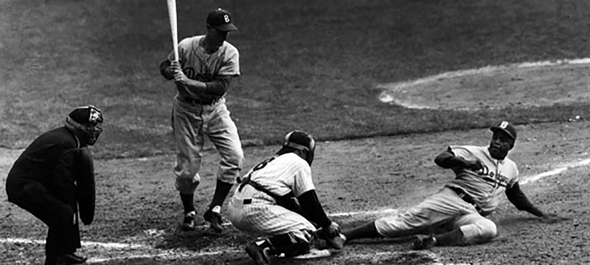 A Brooklyn Dodgers player sliding into home