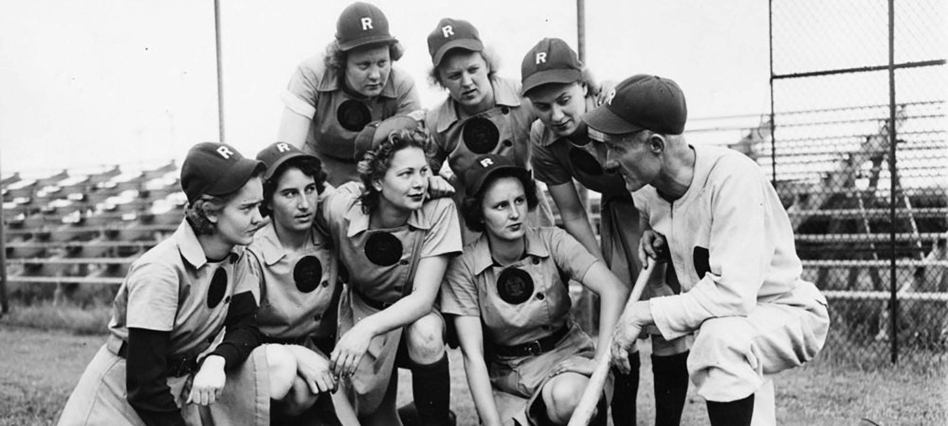 Members of the all-female baseball team the Rockford Peaches gathered on the field