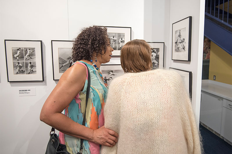 Two visitors look at one of the exhibit photos.
